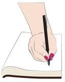 Женское сочинительство руки в тетради Стоковое Изображение RF