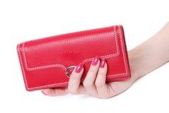 женственный красный цвет портмона руки 2 Стоковые Фото