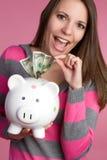 женщина банка piggy Стоковые Изображения
