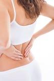 женщина боли в спине терпя Стоковое Изображение