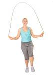 женщина веревочки скачек прыгая Стоковое фото RF