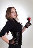 женщина вина стеклянного удерживания чувственная Стоковые Фото