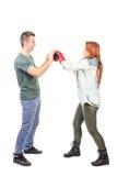 Женщина воюя с человеком Стоковая Фотография