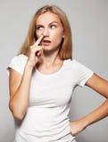 Женщина выбирает его палец носа Стоковые Фотографии RF