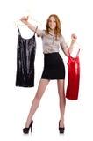 Женщина выбирая изолированное платье Стоковое фото RF