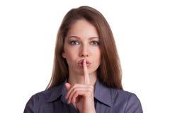 Женщина вызывает для безмолвия, перста на губах Стоковое Изображение