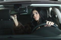 Женщина в автомобиле Стоковая Фотография