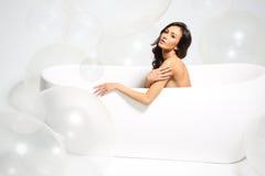 Женщина в ванной комнате Стоковые Изображения