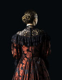 Женщина в винтажном платье стоковое фото