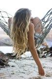 Женщина в гамаке стоковое изображение