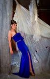 Женщина в голубом платье Стоковые Фото