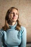 Женщина в голубом свитере Стоковая Фотография