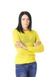 Женщина в желтом цвете при сложенные оружия Стоковое Изображение