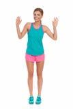 Женщина в живых одеждах спорта показывая 10 пальцев Стоковое Фото