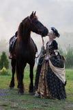 Женщина в катании платья королевском барочном Стоковое Фото