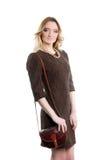 Женщина в коричневом платье. Изолированный стоковое фото rf