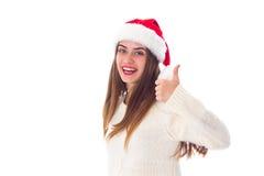 Женщина в красной шляпе рождества показывая большой палец руки вверх Стоковая Фотография RF