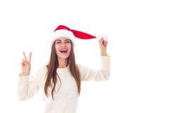 Женщина в красной шляпе рождества показывая мир Стоковая Фотография