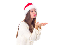 Женщина в красной шляпе рождества посылая поцелуй воздуха Стоковые Фотографии RF