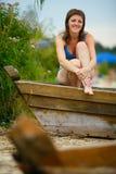 Женщина в купальном костюме в воде Стоковое Фото