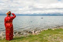 Женщина в национальном платье Стоковые Изображения