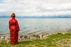 Женщина в национальном платье Стоковое Фото