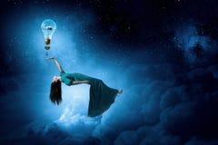 Женщина в ночном небе Стоковое Изображение