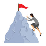 Женщина в одеждах дела взбирается к верхней части горы Стоковая Фотография