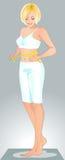 Женщина в одежде спортов Стоковое Изображение