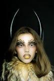 Женщина в пальто и рожках Стоковые Фотографии RF