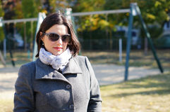 Женщина в пальто Стоковые Фото