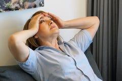 Женщина в печали стоковые фото
