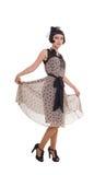 Женщина в ретро введенном в моду платье делая реверанс Стоковые Изображения RF