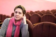 Женщина в театре Стоковая Фотография