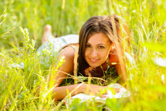 Женщина в траве Стоковая Фотография RF
