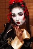 Женщина в традиционном восточном костюме Стоковая Фотография RF