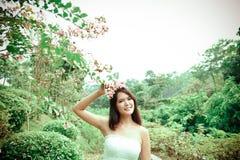 Женщина в цветках Стоковая Фотография RF