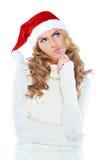 Женщина в шлеме Santa Claus глубоки глубоки думая стоковая фотография rf
