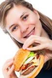 женщина гамбургера счастливая Стоковая Фотография