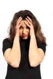 женщина головных болей нажатия Стоковое фото RF