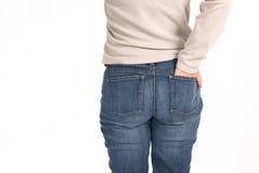 женщина голубых джинсов Стоковое фото RF