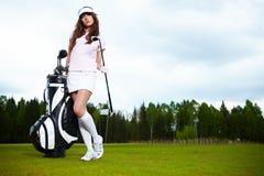 женщина гольфа equpment стоковое фото