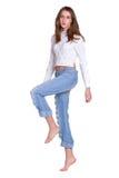 женщина голубых джинсов милая Стоковая Фотография