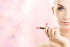 женщина губной помады стоковое фото