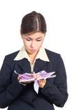 Женщина дела с деньгами стоковая фотография