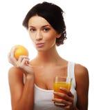 Женщина держа апельсиновый сок стоковое фото rf