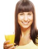 Женщина держа апельсин и сок Стоковое фото RF