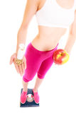 Женщина держа витамины и яблоко здоровье внимательности рукояток изолировало запаздывания Стоковое Изображение