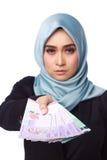 Женщина держа деньги взяточничества Стоковая Фотография RF