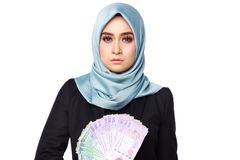 Женщина держа деньги взяточничества Стоковые Фотографии RF